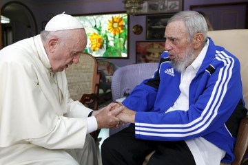 Pope Francis (L) and former Cuban President Fidel Castro hold hands in Havana, Cuba, September 20, 2015. Picture taken September 20. REUTERS/Alex Castro/AIN/Handout via Reuters ATTENTION EDITORS - THIS IMAGE WAS PROVIDED BY A THIRD PARTY. REUTERS IS UNABLE TO INDEPENDENTLY VERIFY THE AUTHENTICITY, CONTENT, LOCATION OR DATE OF THIS IMAGE. IT IS DISTRIBUTED EXACTLY AS RECEIVED BY REUTERS, AS A SERVICE TO CLIENTS. FOR EDITORIAL USE ONLY. NOT FOR SALE FOR MARKETING OR ADVERTISING CAMPAIGNS.       TPX IMAGES OF THE DAY