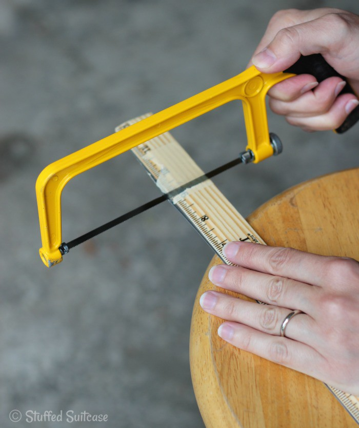 Masking tape to prevent splintering and hacksaw the ruler to the proper size