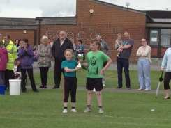 The Green Team collecting the trophy