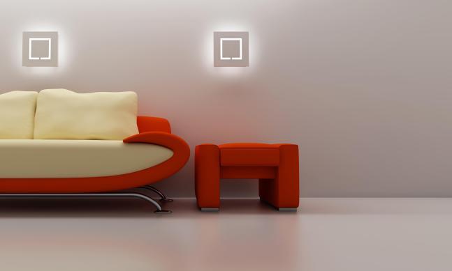 פינת ישיבה מעוצבת בשילוב תאורה בהירה.