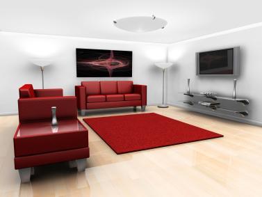 סלון מעוצב באדום חזק בשילוב רצפת דמוית פרקט.
