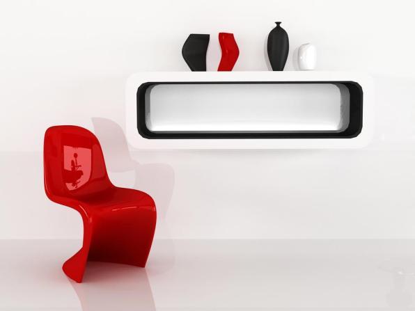 כיסא אדום ברקע קיר לבן עם שילוב של צבע שחור