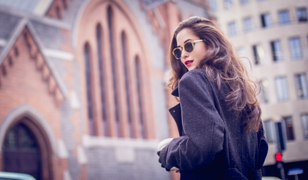 Stunning beautiful woman with red lipstick out in the city, on a lovely day.