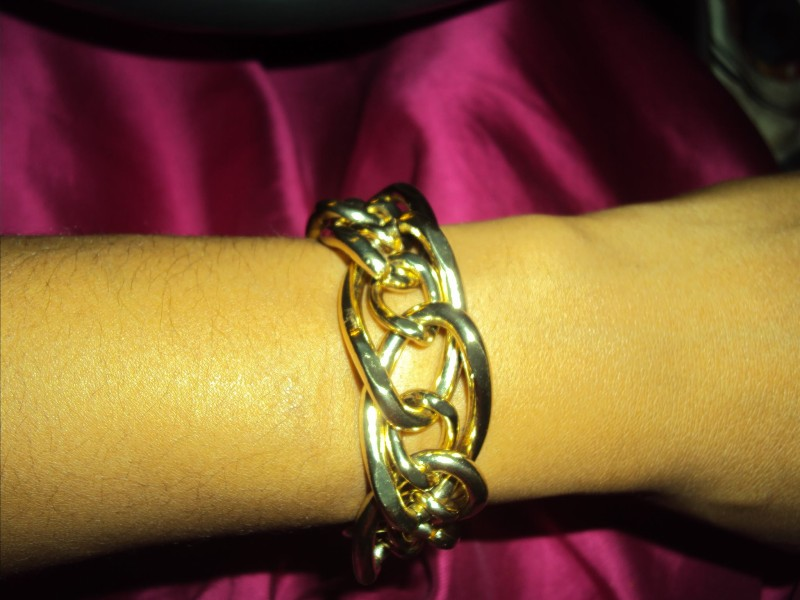 I love to wear at least 4-5 chunky bracelets at a time. Tone the jewelry down for special events.  You'll survive.