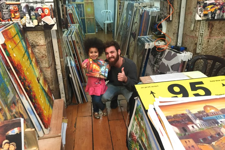 Buying an oil painting in the shouk (market) in Jerusalem