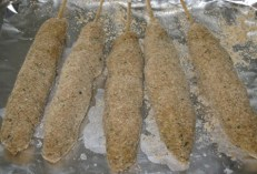 Pork cabobs after second dipping in bread crumbs