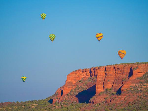 hot air balloons over red rocks sedona arizona