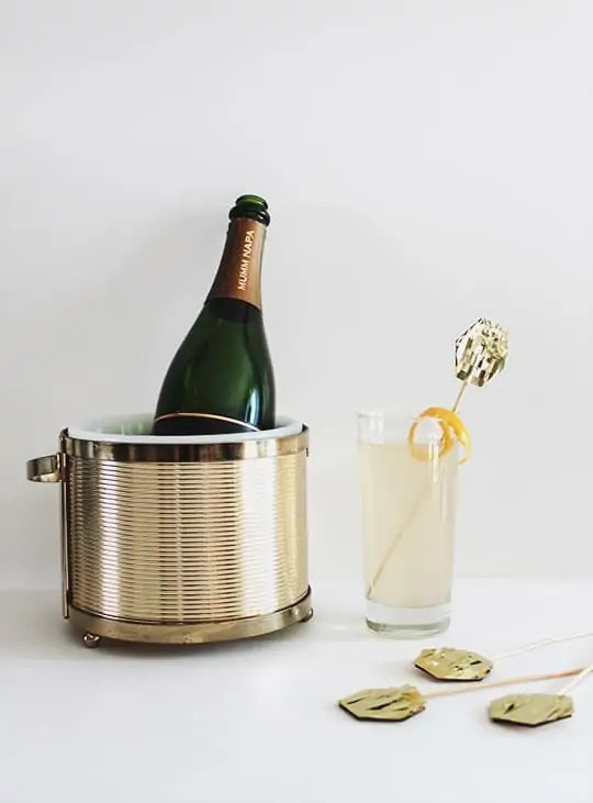 DIY gold fringe cake toppers and a french 75 recipe