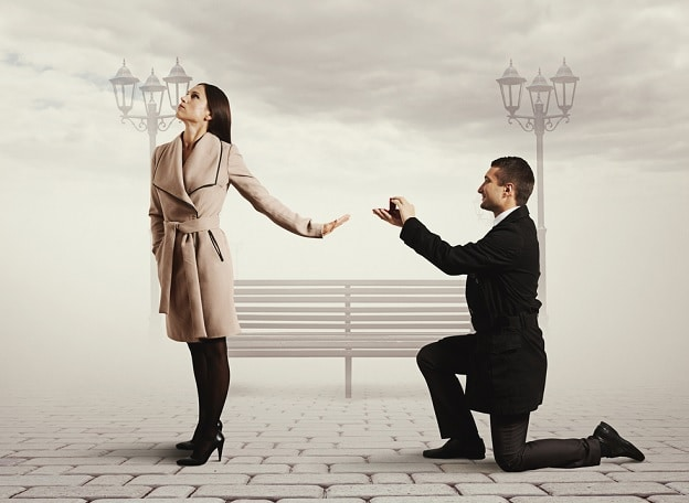 woman-rejecting-a-man-on-his-knee-with-a-ring