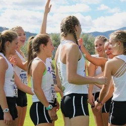 Women's cross country team congratulates each other  after the race in Helena. Photo by Erika Gwinn.