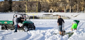Rocky Mountain College assistant and intern football coaches attempt to clear a portion of Herb Klindt Field in preparation for an upcoming recruiting visit. Photo by Riley Howard, Edited by Nicolas Cordero