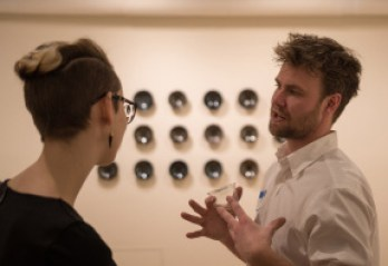 Red Lodge Clay Center resident Matt Fiske discusses his work with Ryniker-Morrisen Gallery intern Ashley Kustka. Photo by Ean McLaughlin