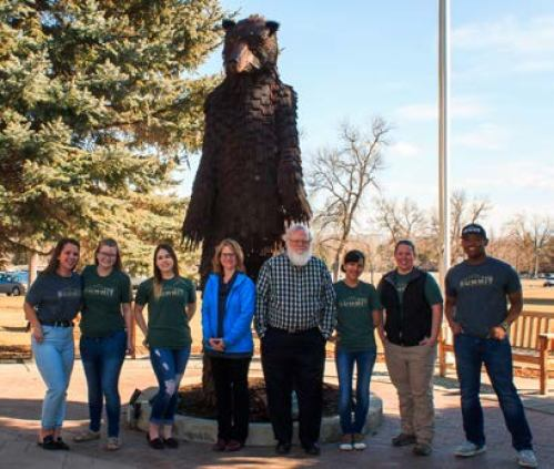 The Summit Team poses in front of The Bear. From left to right: copy editor Jocelyn Anderson, campus reporter Megan Logan, layout editor Kajlea Richards, faculty advisor Precious McKenzie, publications director David Crisp, copy editor Kayla Solis, business Sierra Hentges, and editor in chief Roman Jones. Photo by Megan Logan.