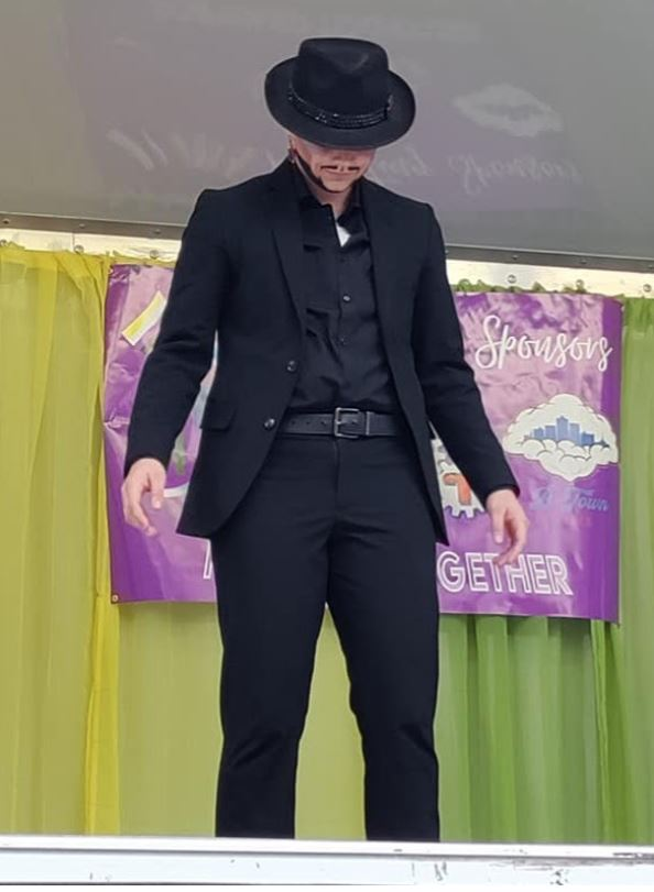 The opening stance for the following act, a slow and powerful performance led by a nonbinary drag king, shows the audience the full scope of the art of drag and its possibilities.