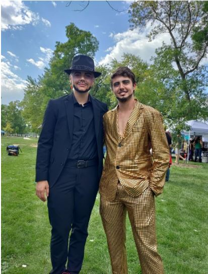 Two drag kings pose for a photo pre-show before going backstage