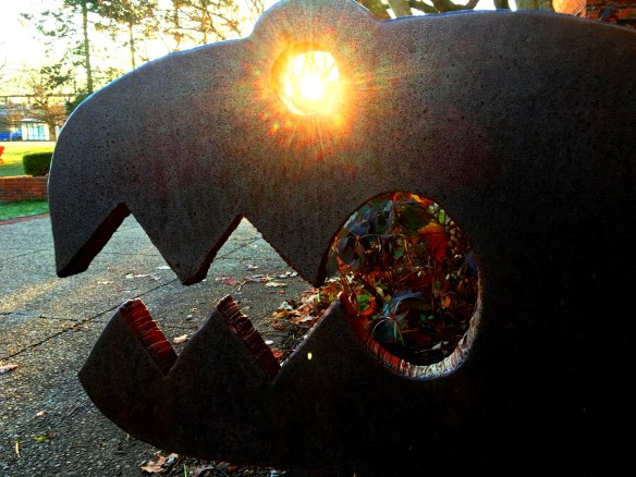The eyes of a metal sculpture glow with the sunrise -- taken at Singletary Center on University of Kentucky Campus