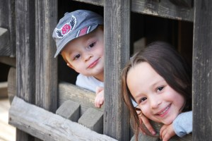 """Two of my grandchildren playing """"Drive Thru Restaurant"""" in one of the many cubby holes."""
