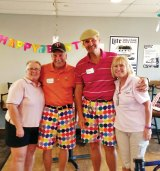 Pictured are Kerry Schuster, Larry Schuster, Don Kleinow and Donna Kleinow. Larry and Don's wild shorts may have helped their game, since their teams had the best scores.