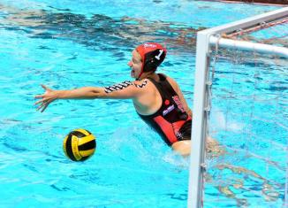 Water polo athlete defends goal