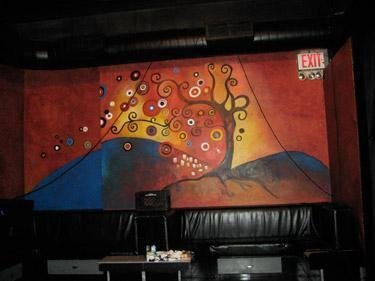 Colorful, red, orange and yellow magical mural wall artwork by Deanna Yildiz
