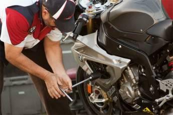 5-Mechanic-checks-bikes.