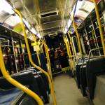 Metropolitan bus interior - blue seats, yellow poles