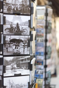 Postcards on display in Paris souvenir shop
