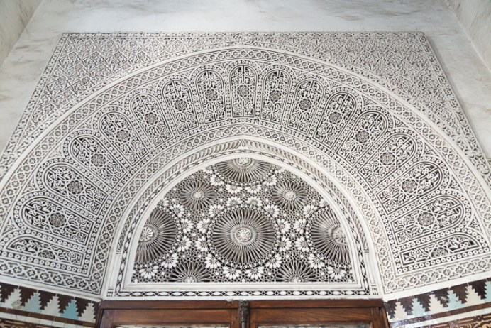 Ornate floral carved pattern above doorway
