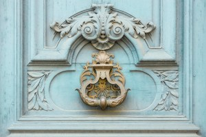 Ornate teal door in paris