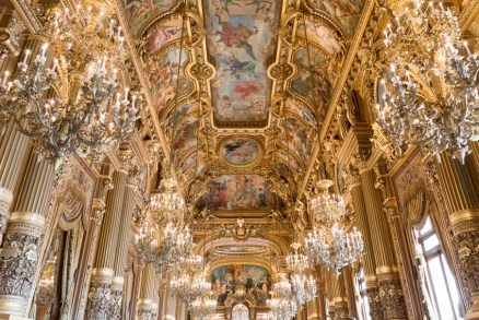Glamorous chandeliers and painted ceiling in the Grand Foyer at Paris Opera house