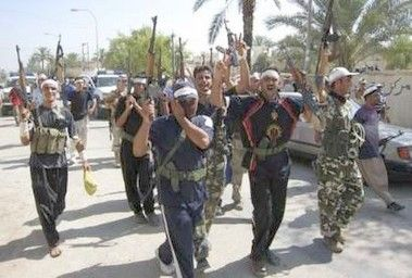 militias_working_with_iraqi_soldiers_raise_their_weapons_after_a_raid_in_baquba