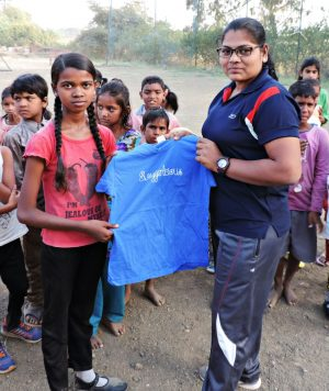 slum soccer girls with swaggarlicious tshirt