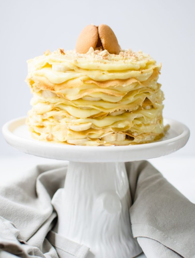 This recipe for 12 Layer Banana Pudding Crepe Cake piles butter crepes with luscious vanilla pudding, sliced bananas, and crushed Nilla wafer cookies! It's fun to make and such a dreamy dessert.