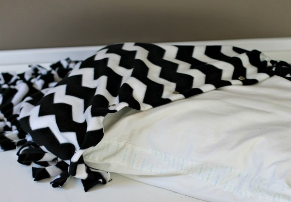 Stuff the pillow inside the blanket