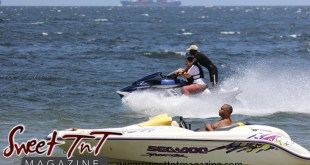 Blue jet ski, man, woman, fat man in white boat at Chaguaramas Beach in Sweet T&T, Sweet TnT Magazine, Trinidad and Tobago, Trini, vacation, travel Chaguaramas Boardwalk