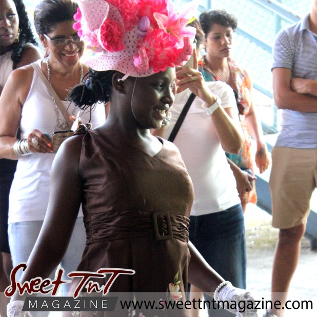 Girl in red bonnet and brown dress, special needs children Easter Bonnet parade at Queen's Park Cricket Club, disney characters on umbrella, Sweet T&T, Sweet TnT, Trinidad and Tobago, Trini, vacation, travel