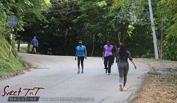 Four women and man exercise walking on Lady Chancellor Hill Port of Spain for story original outdoor gym in Sweet T&T, Sweet TnT, Trinidad and Tobago, Trini, vacation, travel