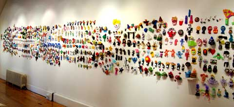 A portion of the Wall of 1000 Finger Puppets.