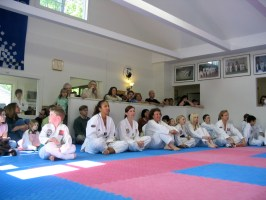 Family and students gather to watch testing from back of the main dojang.