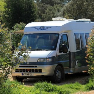 Nobby the Hobby parked in the sun. At Camperstop Messines, Portugal.