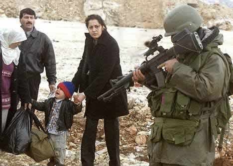 Israel Soldier pointing gun at a terrified child