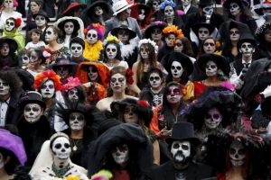 "People with their faces painted to look like the popular Mexican figure called ""Catrina"" take part in the annual Catrina Fest in Mexico City November 1, 2015. According to participants, about 310 women gathered at the Catrina Fest, where women dressed to look like ""Catrina"", a character also known as ""The Elegant Death"", created by Guadalupe Posada in the early 1900s. Mexicans celebrate the annual Day of the Dead on November 1 and 2. REUTERS/Carlos Jasso"