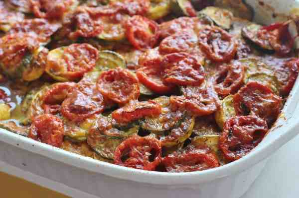 Summer Vegetable Casserole. Layers of squash, zucchini, tomatoes, cheese, herbs and spices.  #tomato #casserole #squash #zucchini #southern