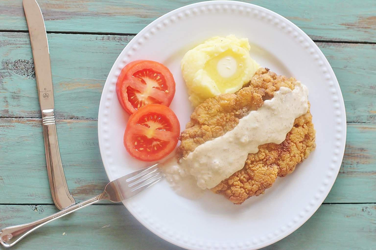 Country Fried Steak with Gravy. Seasoned breaded cube steak fried and ...
