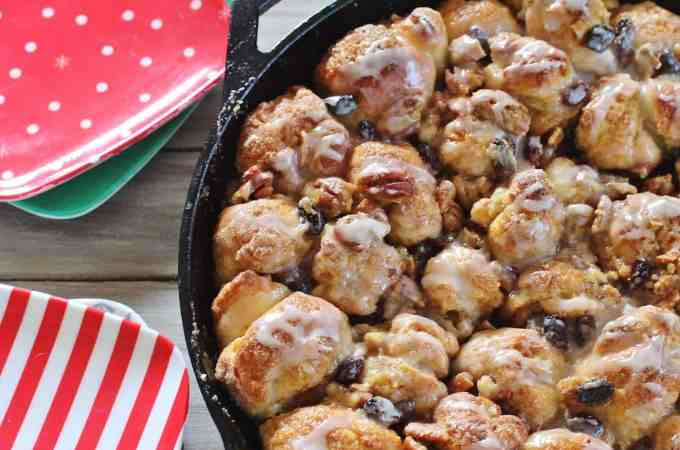 Skillet Monkey Bread. Bits of yeast dough coated in butter and cinnamon sugar, baked with raisins and pecans in a caramel-y topping and finished with buttermilk glaze