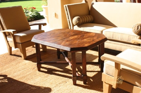 Designed and custom made wood cocktail table with a patterned top.