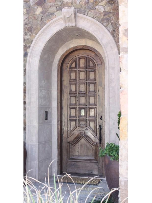 mediterranean style door wood with arch
