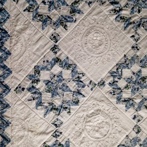 star quilt with lace doilies