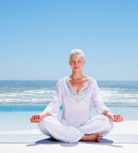 woman yoga beach