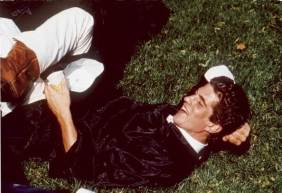 Portrait of John F. Kennedy Jr. (1960 - 1999) as he lies on the the grass in his robe at his graduation from Brown University, Rhode Island, 1983. (Photo by Allan Tannenbaum/The LIFE Images Collection/Getty Images)